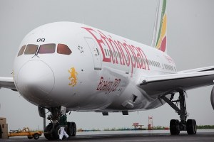 The first Ethiopian 787 Dreamliner is pulled into its parking spot prior to a VIP flight to Mt Kilimanjaro.  note the new titles.