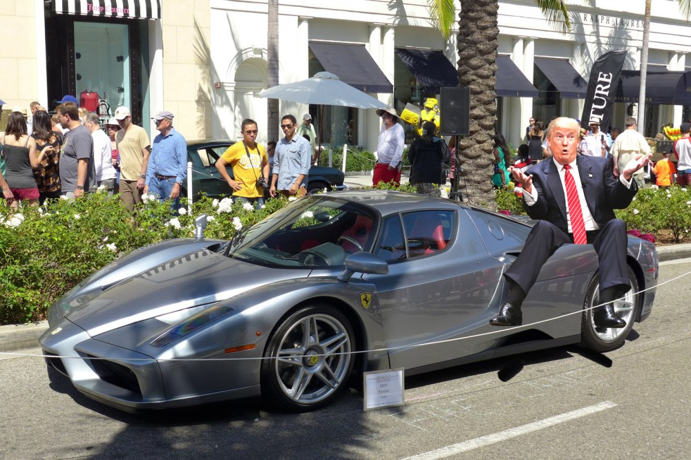 Donald Trump Sitting on a Ferrari Enzo - MotoringExposed