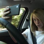 Selfie-snapping while driving