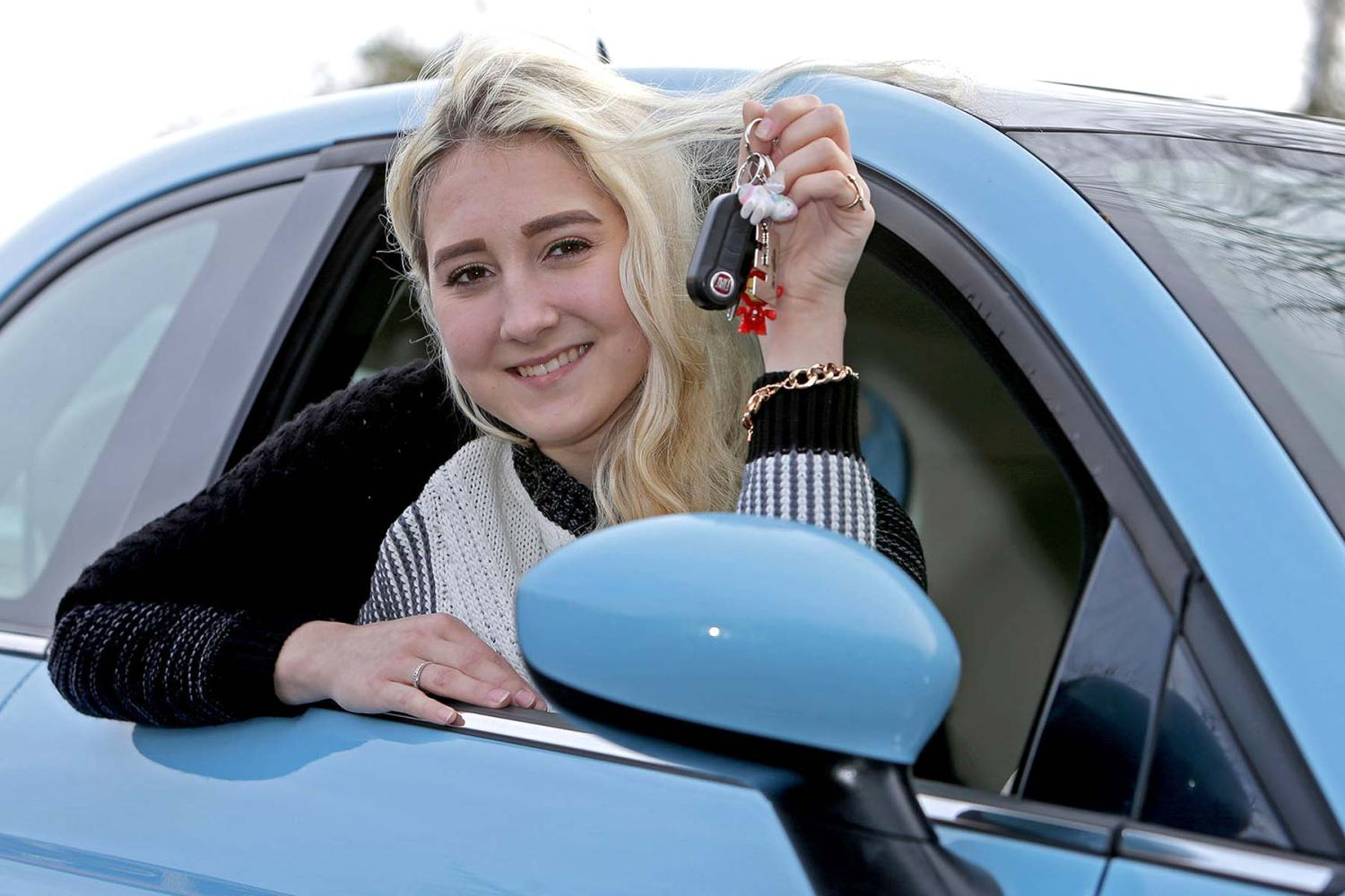 Young driver in her first car