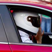 Person in traffic wearing a helmet