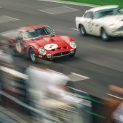 A Ferrari 250 GTO overtakes an Aston Martin DB4 GT. Taken by Richard Pardon for Goodwood