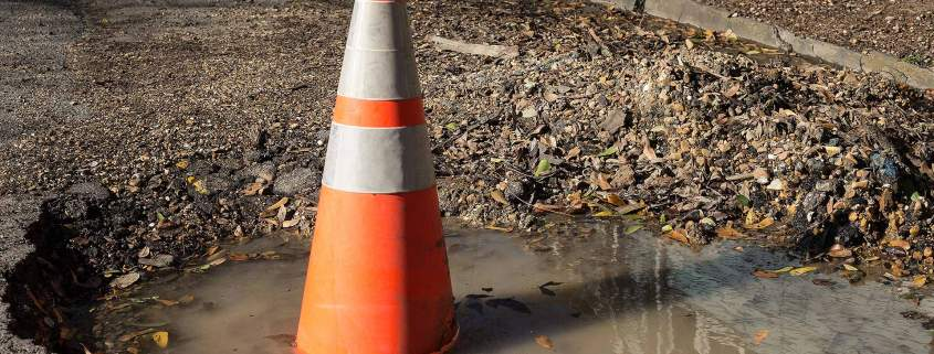 Traffic cone in a pothole