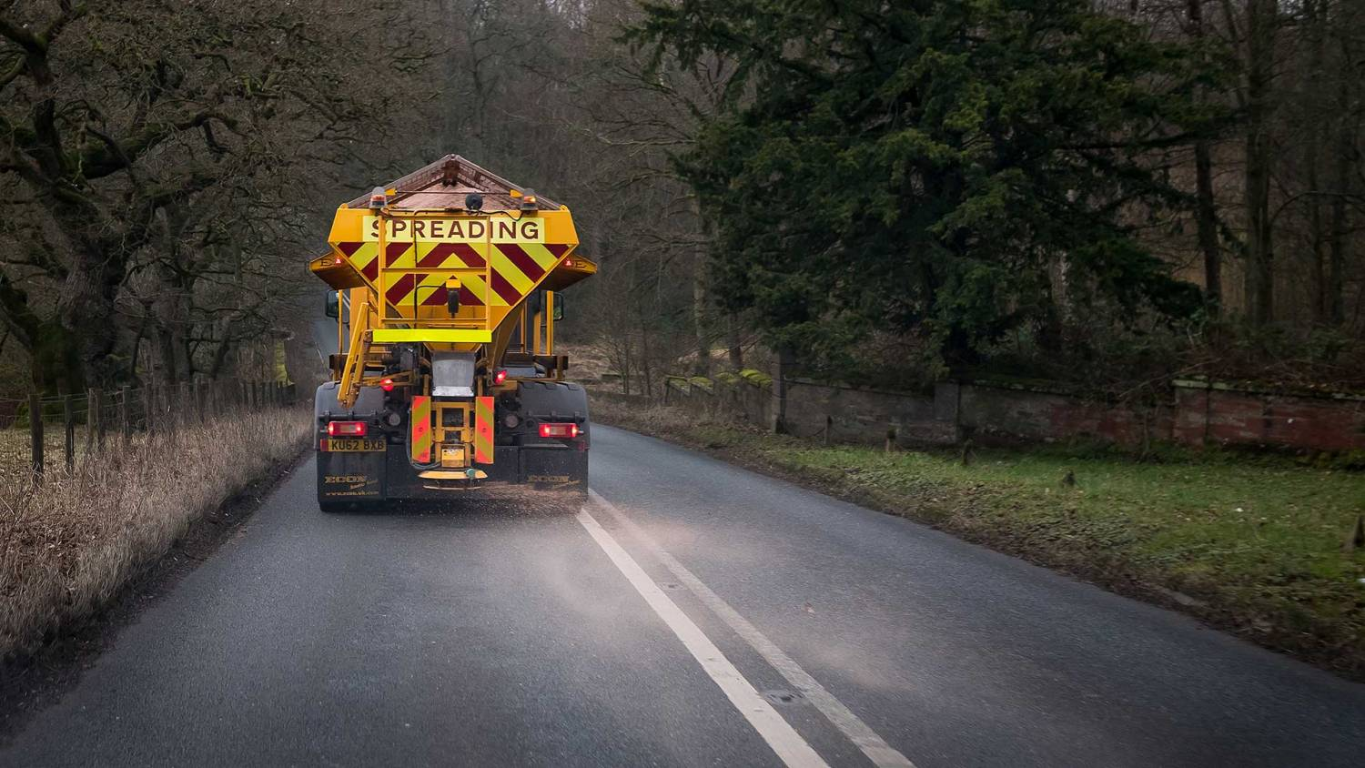 Road gritter spreading salt on a British road