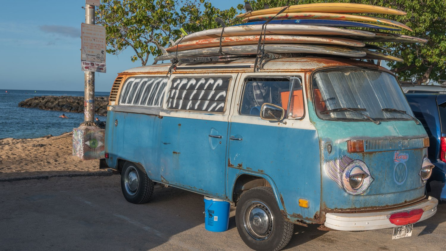 Most surfboards stacked on a car