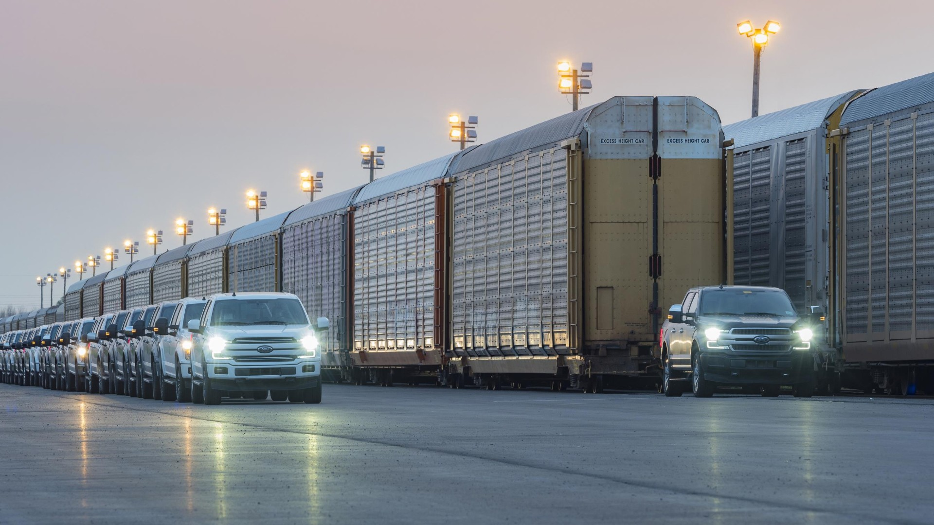 Ford shows off electric F-150 pickup by towing a freight train