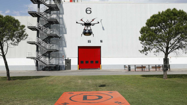 Drone delivering car parts