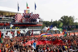 Supporters of Ferrari Formula One driver Alonso of Spain celebrate under the podium after the Italian F1 Grand Prix at the Monza circuit