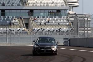 84826_Sebastian Vettel laps Sochi GP circuit in an Infiniti Q50