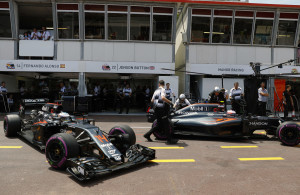 Fernando Alonso and Jenson Button in the pits.