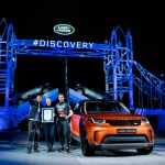 bear-grylls-zara-phillips-and-sir-ben-ainslie-with-the-new-land-rover-discovery-at-its-global-unveiling-in-front-of-the-worlds-largest-lego-structure