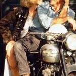 Couple sitting on stationary motorbike
