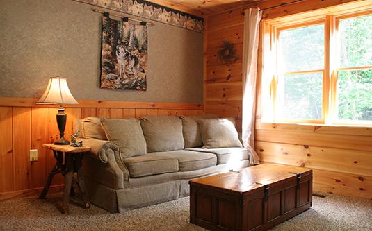 sofa sleeper for cabin latest design wood set a wolf s den gatlinburg log in tn tennessee