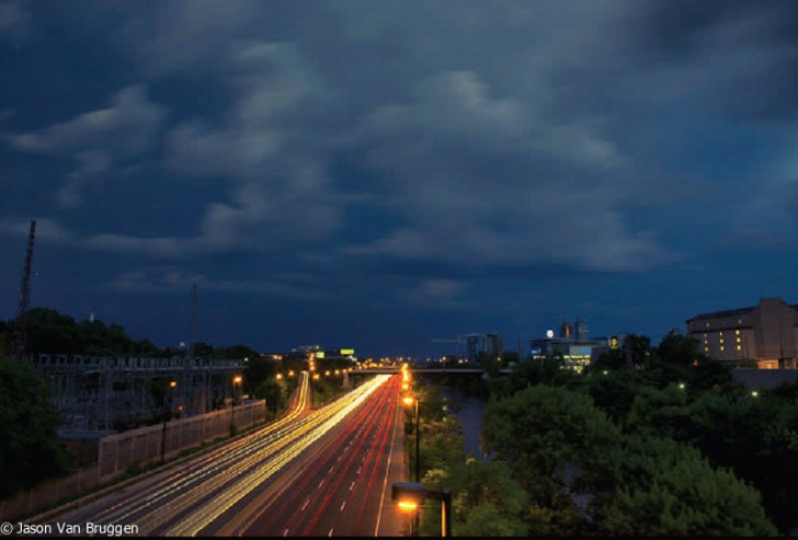 A long exposure of the Don Valley Parkway from the Gerrard St. bridge. This was one of many unusually significant thunder storms that erupted over Toronto in the Summer of 2013. The Don Valley Parkway was completely flooded twice. It was quite remarkable seeing cars underwater and passengers completely stranded. It felt like a pretty convincing proof point for climate change to me.