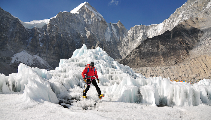 Ed Viesturs traverses an Everest icefall. Photo by Jake Norton.