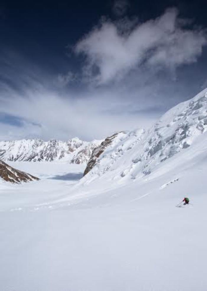 Holly Walker descends a safe slope towards the Fedchenko Glacier