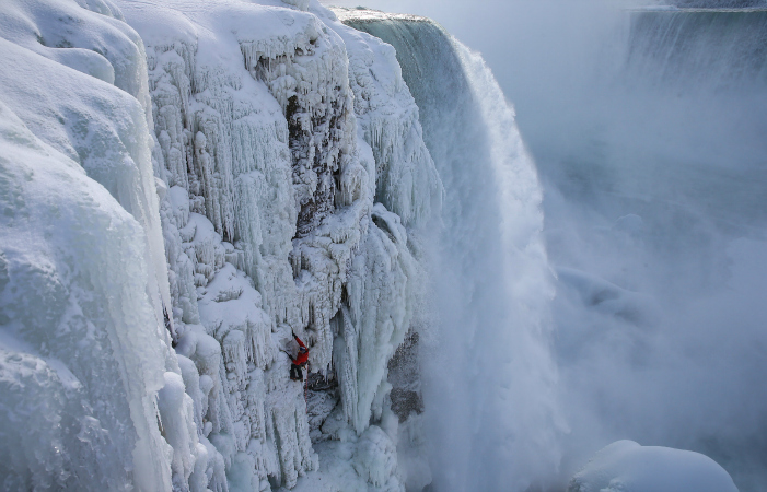 Will Gadd ice climbs the first ascent of Niagara Falls in Niagara Falls, NY, USA on 27 January, 2015.