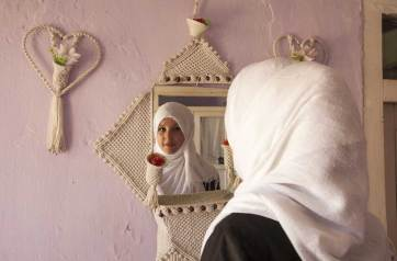 Zahra takes one last look before going to her high school. She wants to become a doctor. Jenny Nichols photo.