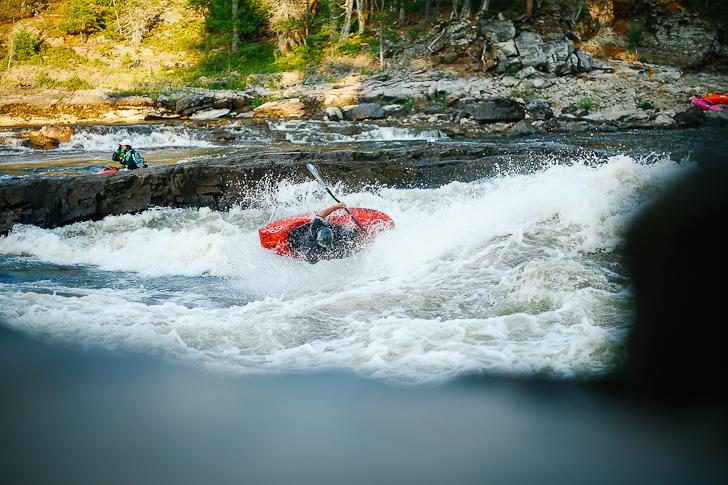 Kalob Grady surfs Garb on the Ottawa River in Beachburg, ON. Photo by John Rathwell.