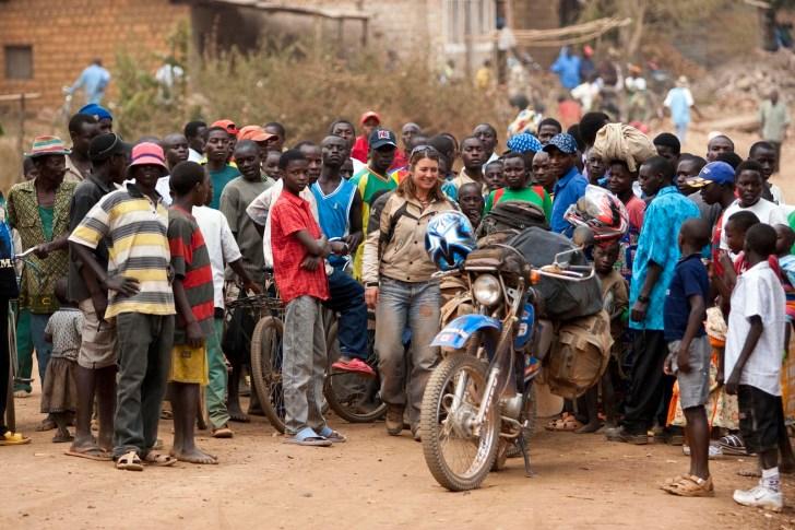 Burundi's rural folk crowd us instantaneously.