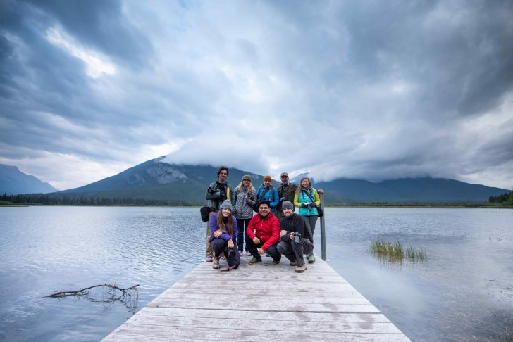Group of Banff Photography Residence in front of lake