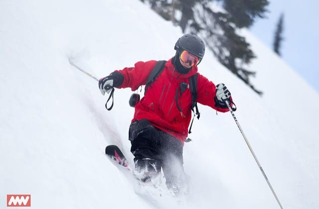 heli ski guide getting some powder turns