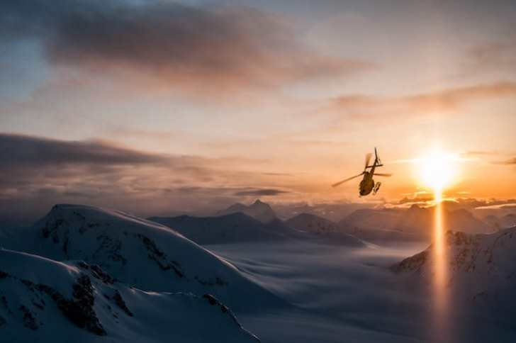 Helicopter flying to pick up Heli-Skiers in Northern British Columbia