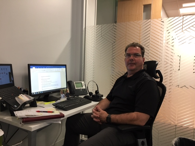 Doug Brogdan at his desk