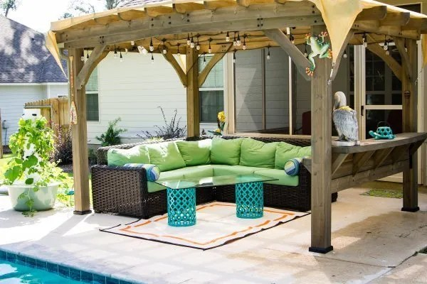 Pool patio with table and plastic indoor/outdoor rug mat