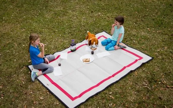 two girls having a picnic on a Mountain Mat