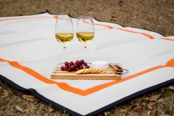 wine and cheese board on Orange and White Mountain Mat
