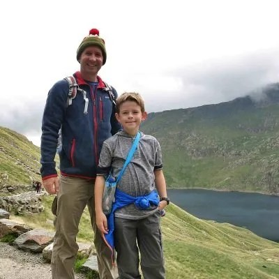 father and son on trail up mount snowdon