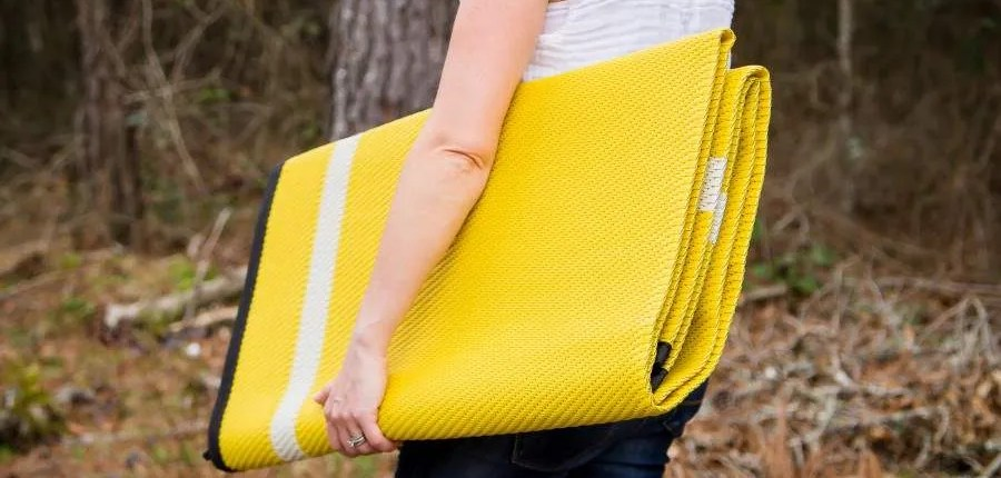 folded yellow reversible outdoor polypropylene mat