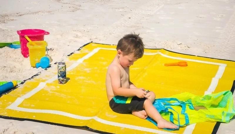 boy on yellow 5x7 mountain mat beach blanket mat