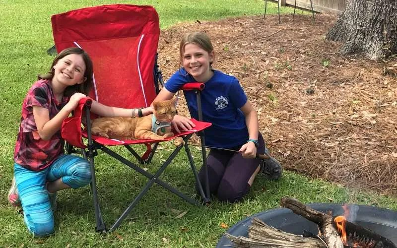 2 girls and a cat camping