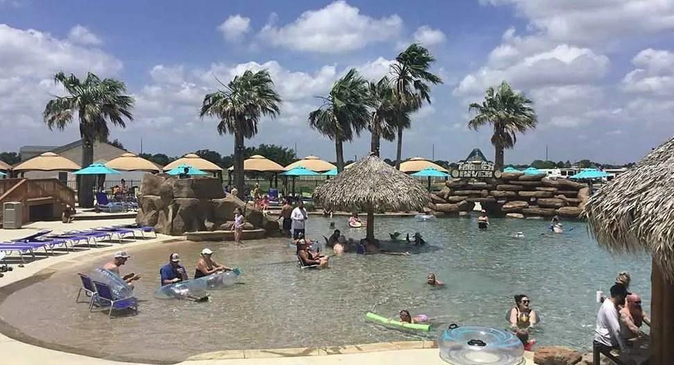 people at a swimming pool at el campo rv resort