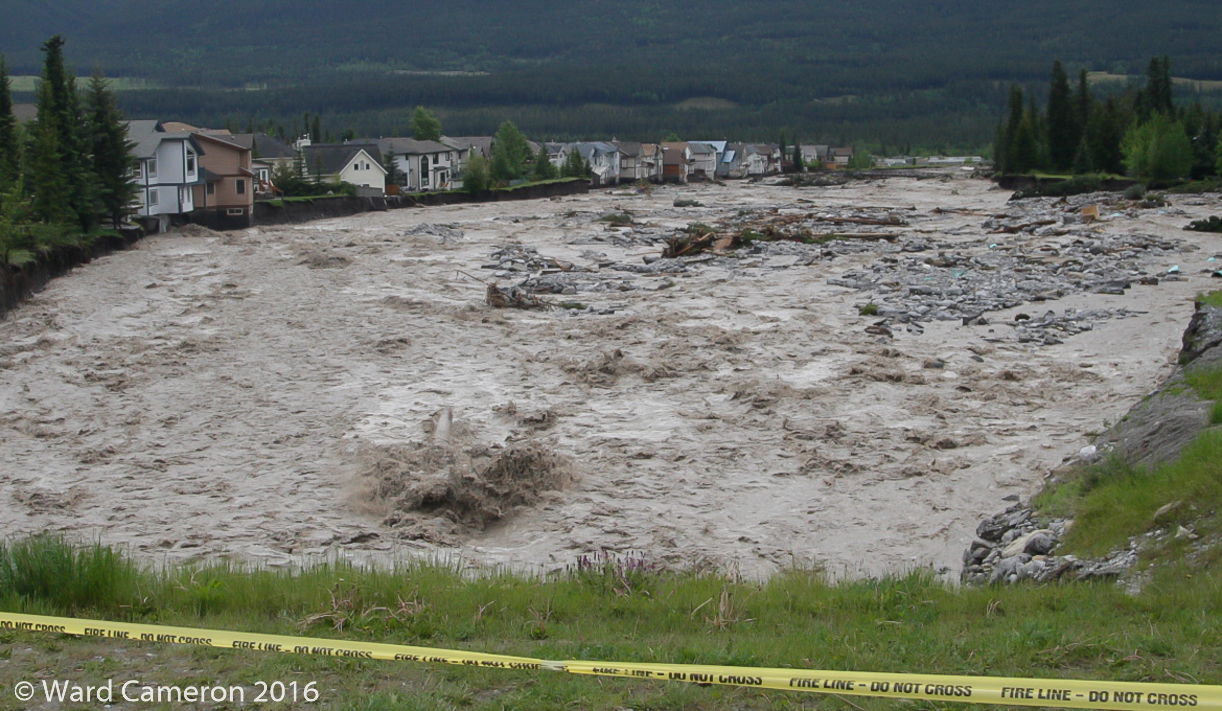 Undercutting of houses along Cougar Creek during the floods in Canmore in 2013