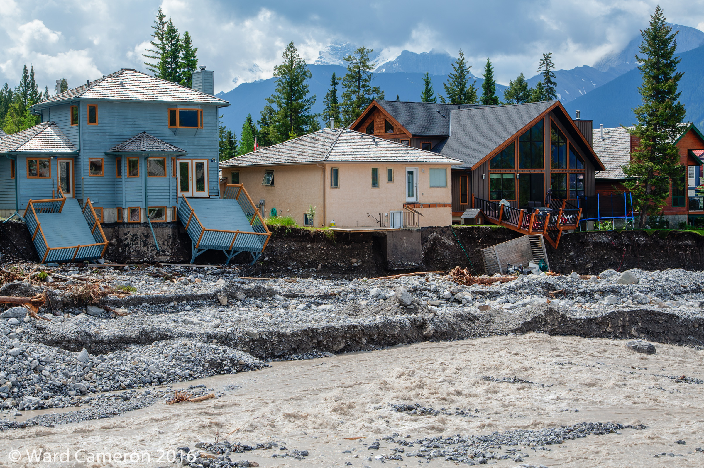 Damage to houses along Cougar Creek in Canmore in 2013