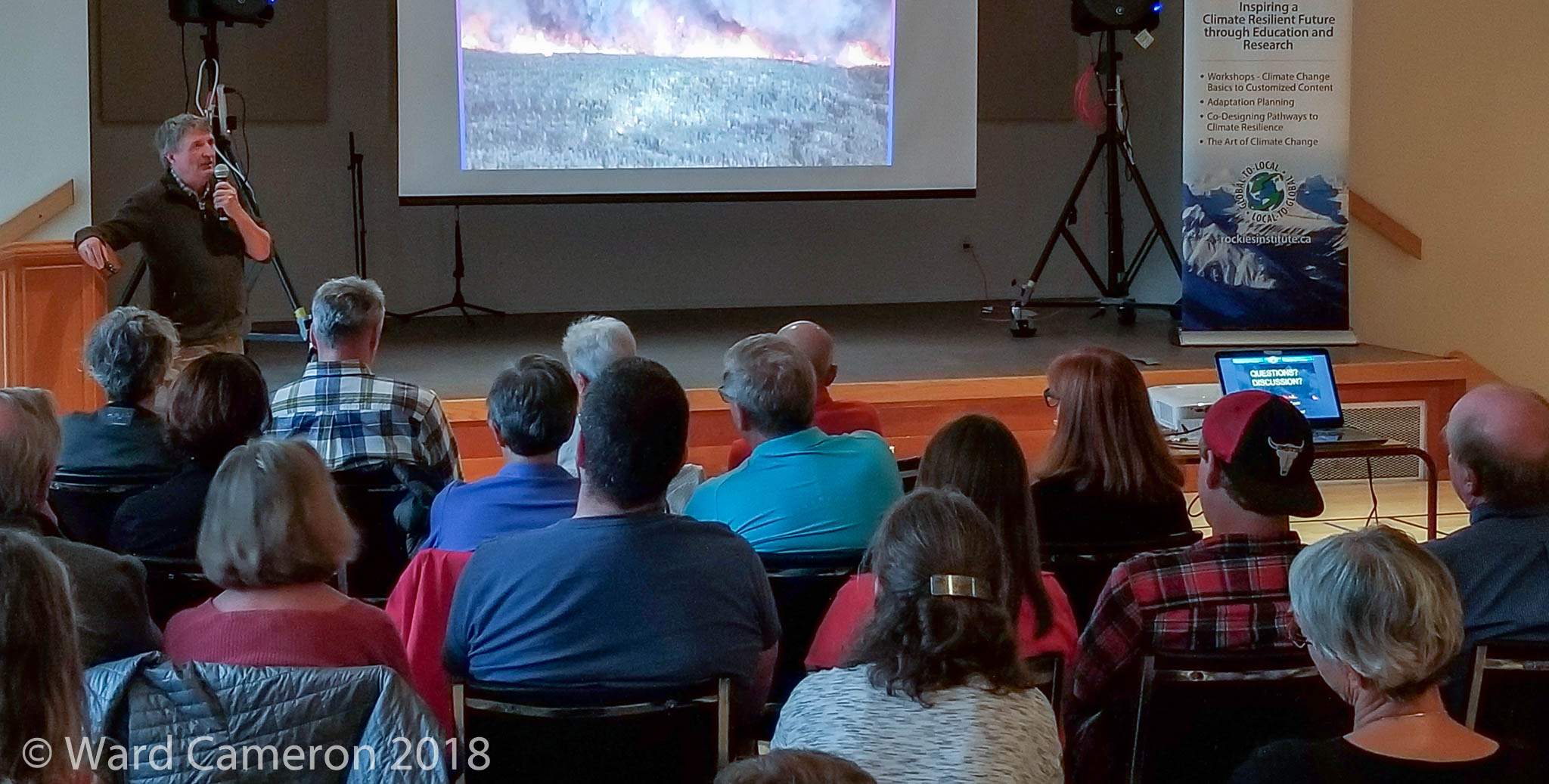 photo of Cliff White talking about fire ecology