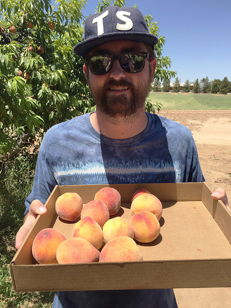 A happy peach picker and his finely selected peaches. It's quality, not quantity!
