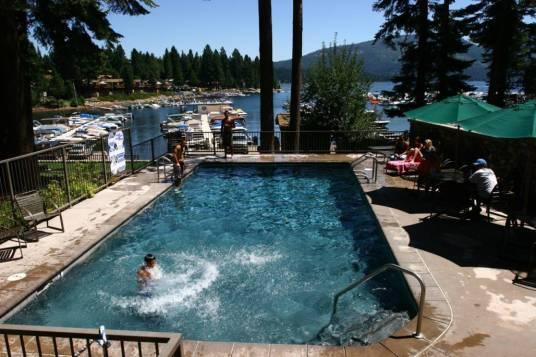 Knotty pine pool overlooking lake