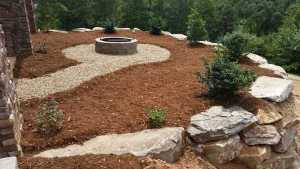 Boulder Wall , Fire pit and River Pebble Pathway