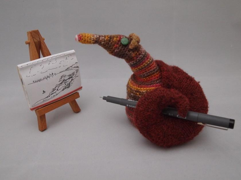 Ether Vaark works on a sketch at her easel.
