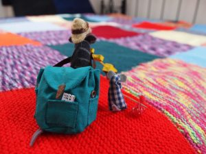 Bernard and Microvaark set off across a huge blanket of knitted squares