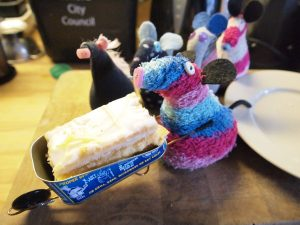 Ratvaark is pushing the custard slice away in the wheelbarrow