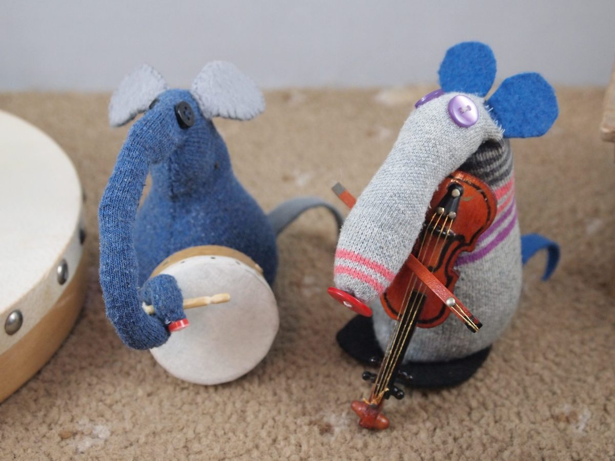 Dim and Ernest are playing a violin and a little Irish drum