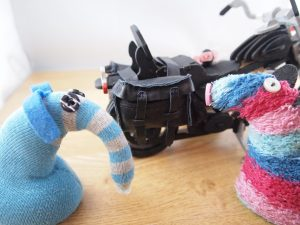 Arnold shows off the new black leather pannier bags on his motorbike.