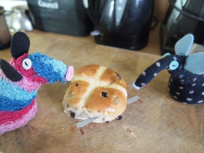 Winston slices the hot cross bun with a tree saw