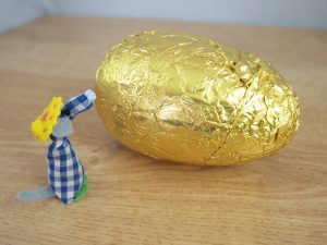 Microvaark is looking at an egg much bigger than him!