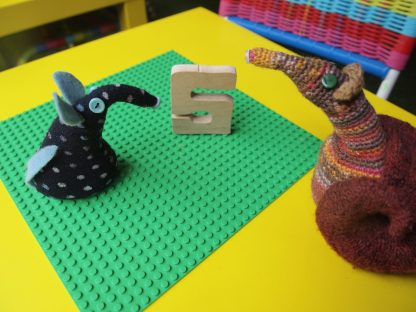 Winston and Esther look at a wooden letter S the right way round